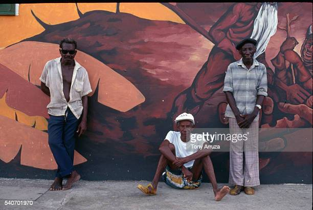 men alongside a mural in anse la raye, st. lucia - raye stock pictures, royalty-free photos & images