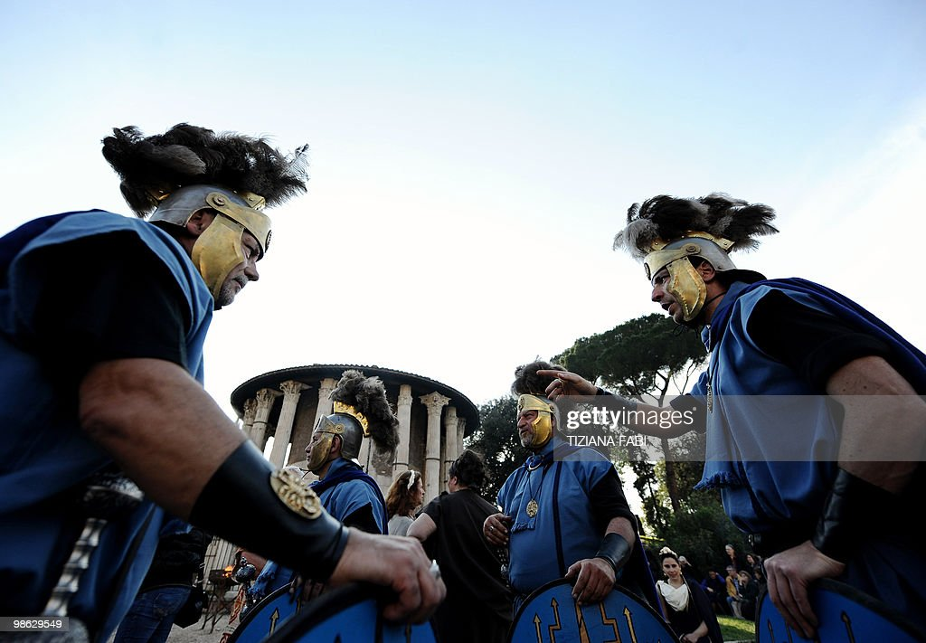Men an women dressed up as ancient Roman soldiers perform the ancient bucolic fest at Tempio di Vesta on April 21, 2010, in Rome during a ceremony to celebrate the anniversary of the legendary foundation of the city of Rome, on April 21, 753 B.C. AFP PHOTO/Tiziana Fabi