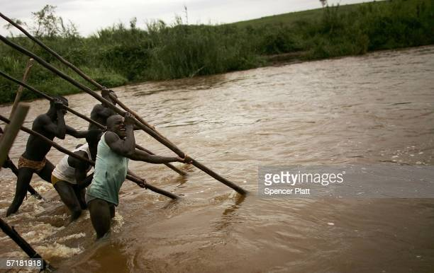Men and boys mine for gold in a river March 24 2006 in Bunia Congo Gold deposits which are numerous in the volatile northeast of the country have...