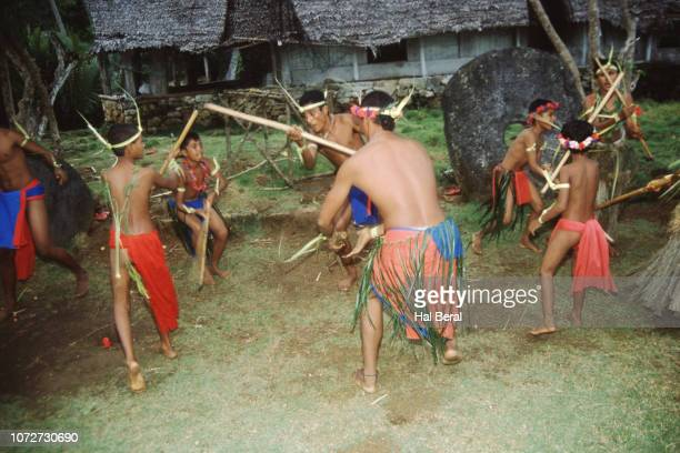 men and boys performing traditional dance - men stockfoto's en -beelden
