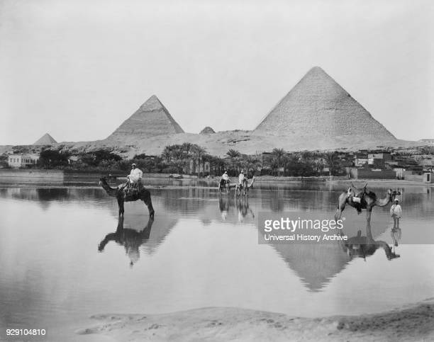 Men and Camels in Shallow Flood Water with Pyramids in Background Egypt 1890