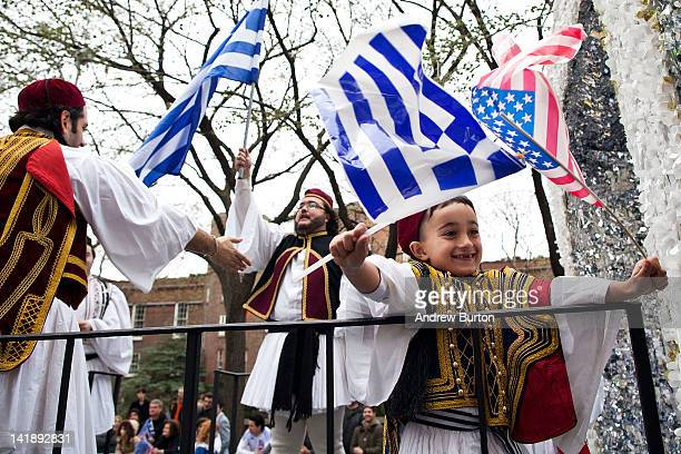 Men and children dance on a parade float during the annual Greek Independence Day Parade on March 25 2012 in New York City It was the 191st annual...