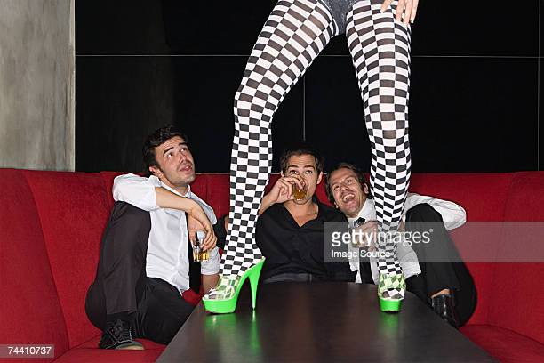 men and legs of table dancer - lech stock photos and pictures