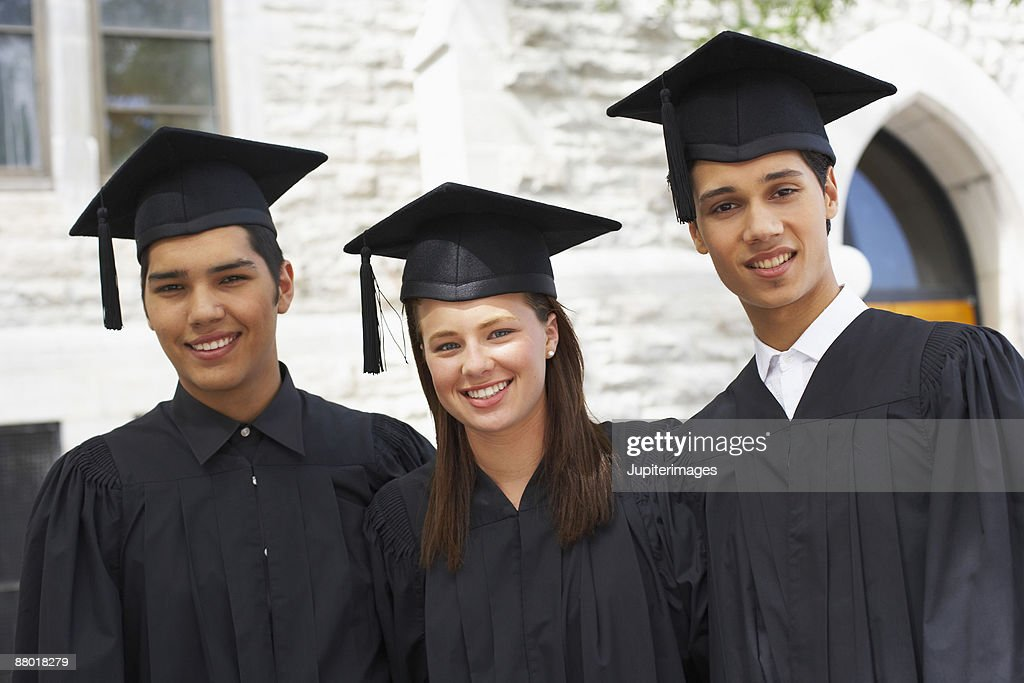 Men And Woman In Graduation Cap And Gown Stock Photo | Getty Images