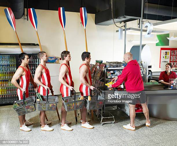 Men and women at supermarket
