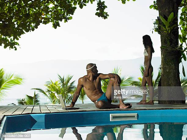 Men and women by poolside