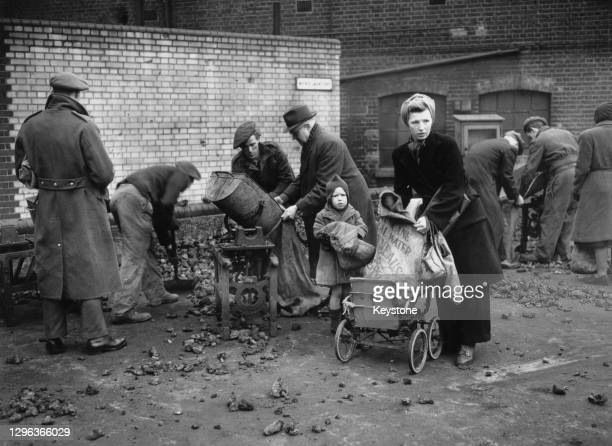 Men and women collecting their coke and coal rations in sacks from the South Metropolitan Gas Company's depot on 13th February 1947 in Vauxhall,...