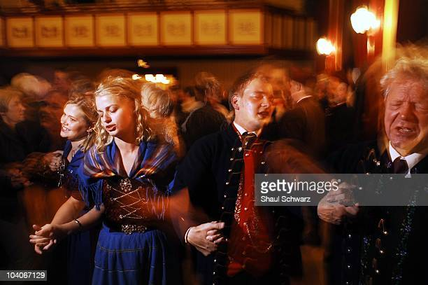 Men and women dance a famous heritage chain dance during St Olav's Day The National Festival in Torshavn the capital of the Faroe Islands on July 28...