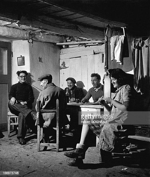 Men and women discussing in the early in the morning, 1947 in Saint-Veran, France.