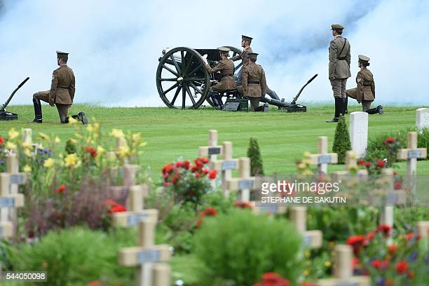 Men and women dressed as World War I soldiers load a cannon as they take part in the memorial ceremony on July 1 2016 at the Thiepval Memorial in...