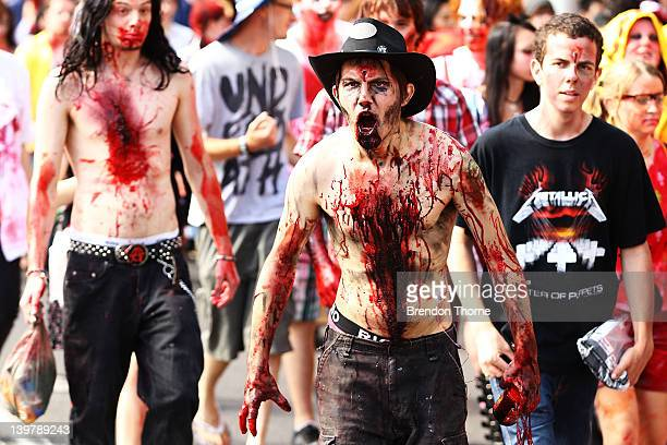 Men and women dressed as zombies walk the streets of Sydney on February 25 2012 in Sydney Australia The annual Zombie Walk raises money for the Brain...