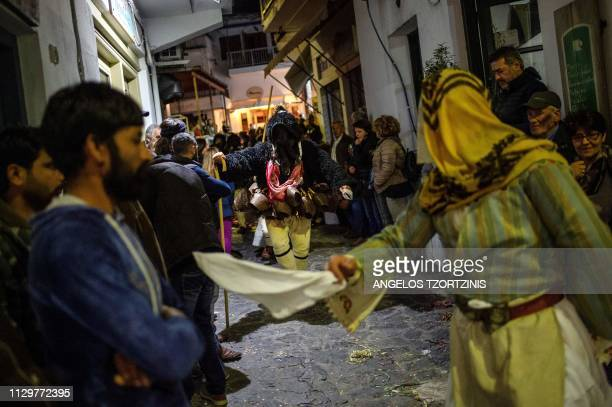 Men and women dressed in costumes of ''Old man'' and ''Corela'' take part in the Skyrian Carnival on the island of Skyros northeast of Athens on...