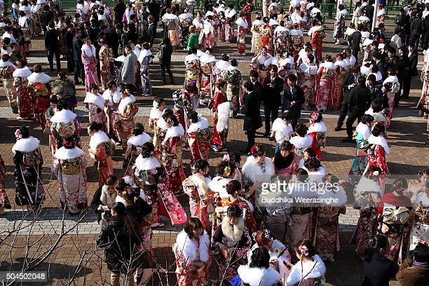 Men and women dressed in Kimono and suits attend the Coming of Age Day ceremony outside of Noevir Stadium on January 11 2016 in Kobe Japan The Coming...