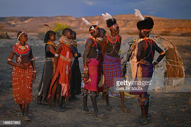 Men and women from the Turkana tribe take part in a ceremeony in the Sibiloi national Park in the Turkana region on November 2 2013 Around 1500...