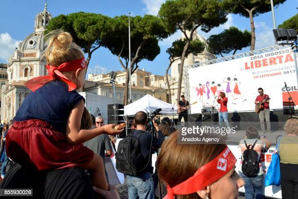 Men and women gather to protest against genderbased violence in Rome Italy on September 30 2017