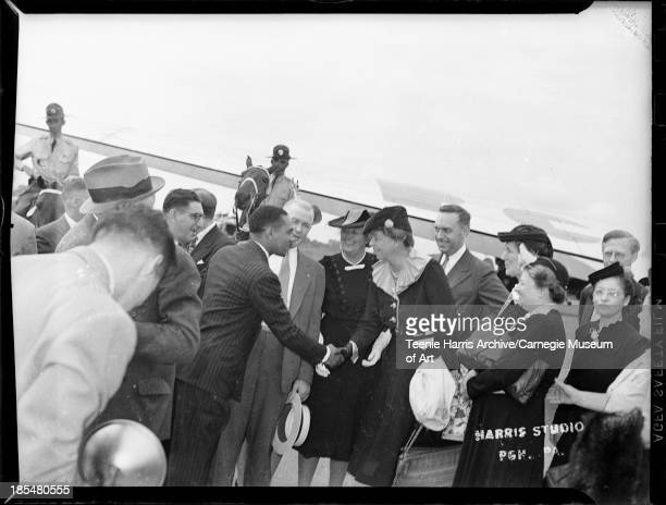 Men and women greeting Eleanor Roosevelt at Allegheny County Airport with mounted police in background Allegheny County Pennsylvania August 1941