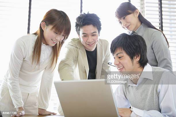 men and women having meeting, smiling - ビジネスウェア ストックフォトと画像