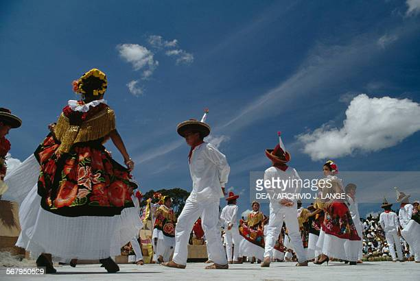Men and women in traditional costumes Jarabe Mixteco dance during the celebrations at the Guelaguetza festival Oaxaca Mexico
