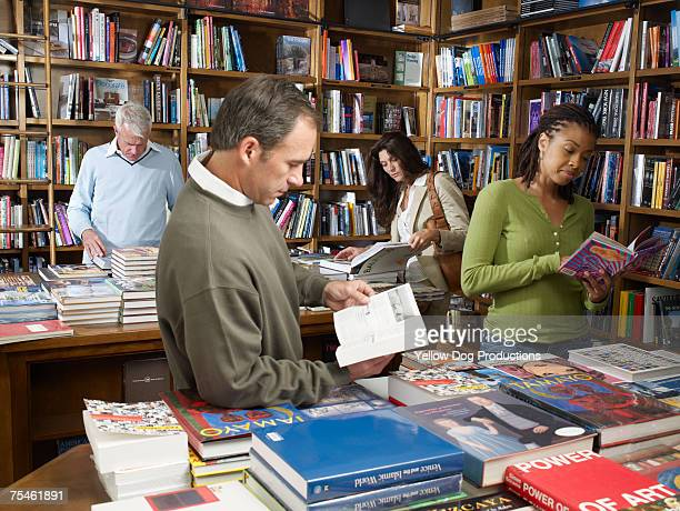 Men and women looking through books in bookstore