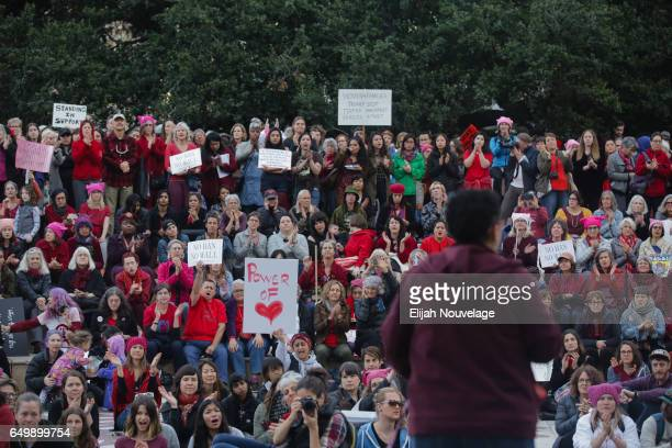 Men and women mark International Women's Day by attending a protest at City Hall on March 8 2017 in Oakland California Protest marches across the...