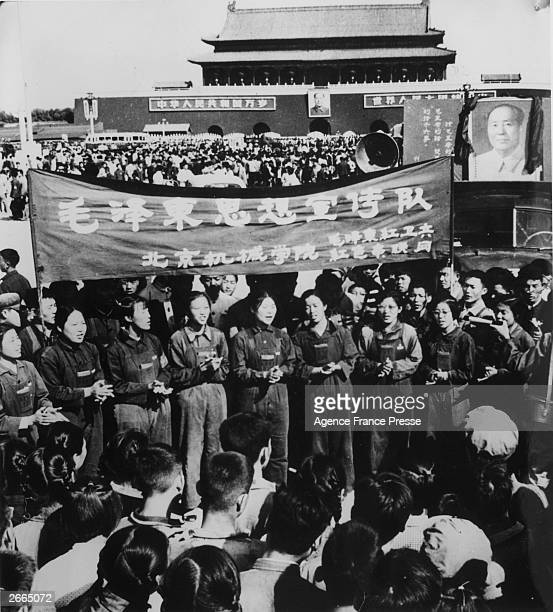 Men and women of the Red Guards spreading the words of Mao at a rally held in Tiananmen Square Peking