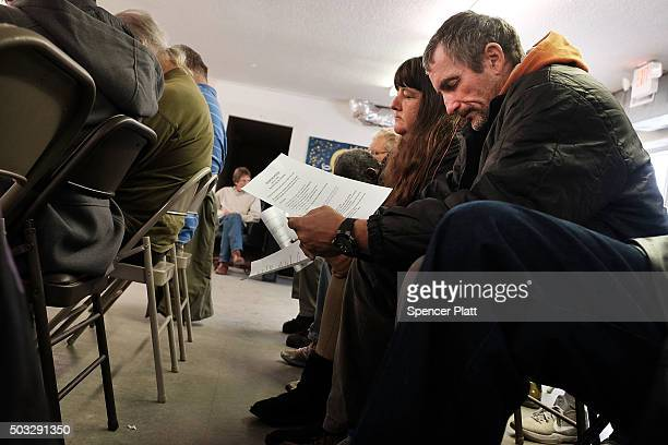 Men and women participate in a church service before a meal at the Seashore Mission which offers services to the homeless and those in need on...