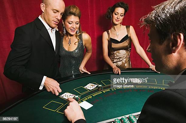 Men and women playing blackjack
