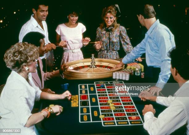 Men and women playing roulette in a casino at Las Vegas Nevada USA 1980s