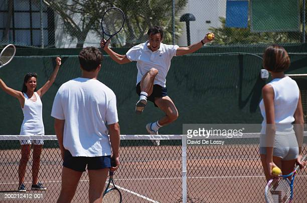 men and women playing tennis, mixed doubles - doubles sports competition format stock pictures, royalty-free photos & images
