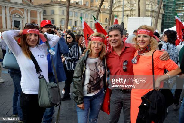 Men and women pose for a photo together during a protest against genderbased violence in Rome Italy on September 30 2017