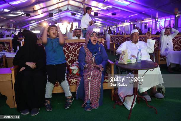 Men and women react to play as they watch the Saudi Arabia vs Egypt 2018 World Cup match at a public viewing in a tent on June 25 2018 in Jeddah...