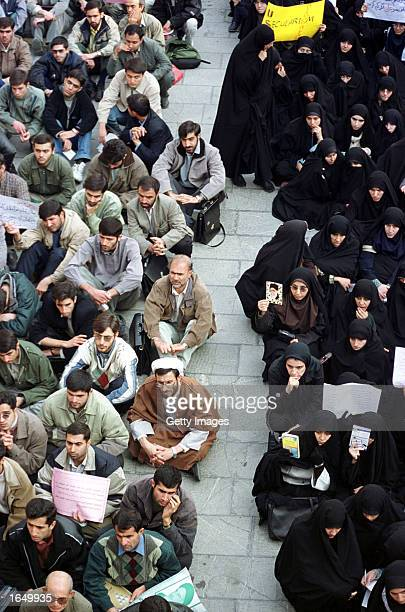 Men and women sit separately during a demonstration by student members of the Basij during a demonstration at Tehran University November 19, 2002 in...