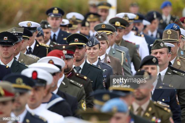 Men and women soldiers from different nations march in the opening ceremony at the 2018 NATO Summit at NATO headquarters on July 11 2018 in Brussels...