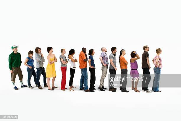 men and women standing in a line - lining up stock pictures, royalty-free photos & images