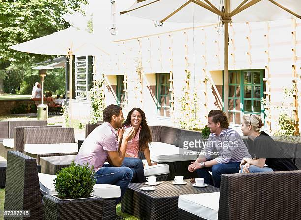 Men and women talking over drinks
