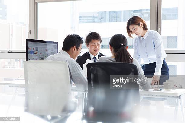 men and women to discuss happily - east asia stock pictures, royalty-free photos & images