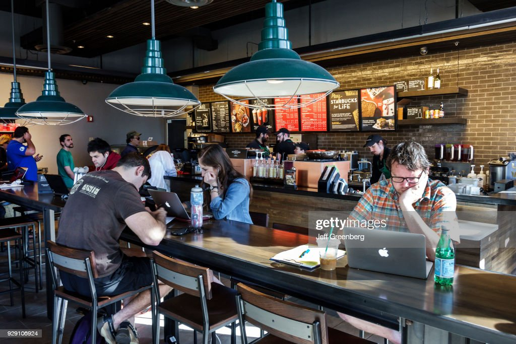 Men And Women Using The Internet Access In A Starbucks Coffee In News Photo Getty Images