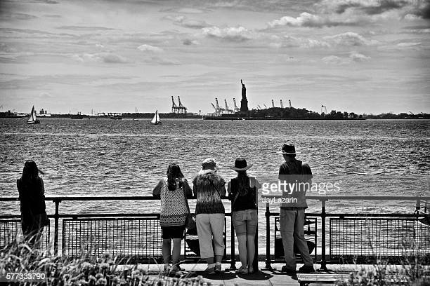 Men and Women Viewing Statue of Liberty from Battery Park