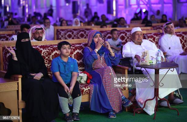 Men and women watch the Saudi Arabia vs Egypt 2018 World Cup match at a public viewing in a tent on June 25 2018 in Jeddah Saudi Arabia The Saudi...