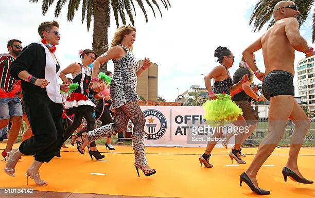 Men and women wearing high heeled shoes take part in a Guinness World Record attempt for the largest amount of people running in high heels on...
