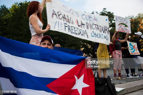 Men and women with flags and banners gather in support of Cuban protesters in Union Square Park on July 14, 2021 in New York City. A small group of...