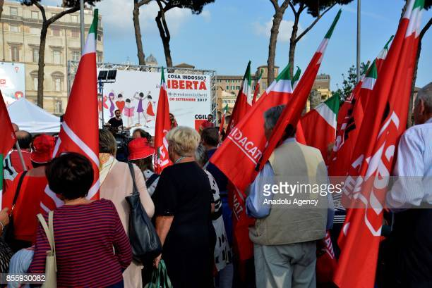 Men and women with flags of Italy gather to protest against genderbased violence in Rome Italy on September 30 2017