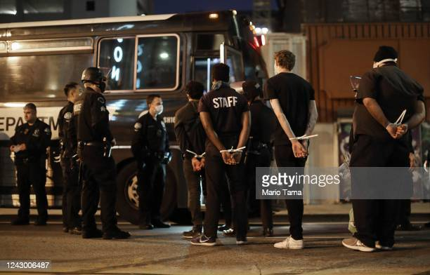 Men are arrested after curfew went into effect during mostly peaceful demonstrations over George Floyd's death downtown on June 2, 2020 in Los...