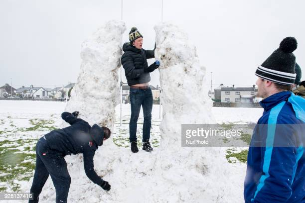 Men are building a snow gate at The south park in galway which was covered with snow on Friday March 2 in Galway Ireland A blast of Siberian weather...