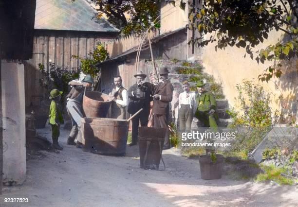 Men are emptying the tubs Lower Austria Handcolored lantern slide Around 1915