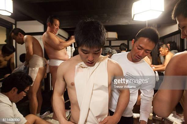 Men are fitted into loincloths at the Hadaka Matsuri or Naked Festival at Saidaiji Temple on February 20 2016 in Okayama Japan Some 9000 men battle...