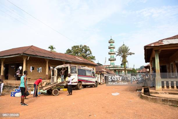 men are loading a truck in freetown, capital of sierra leone. - sierra leone stock pictures, royalty-free photos & images