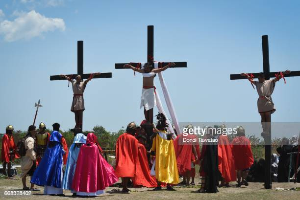 Men are nailed to the cross during Good Friday reenactments of the passion of Christ on April 14 2017 in San Pedro Cutud village in San Fernando town...