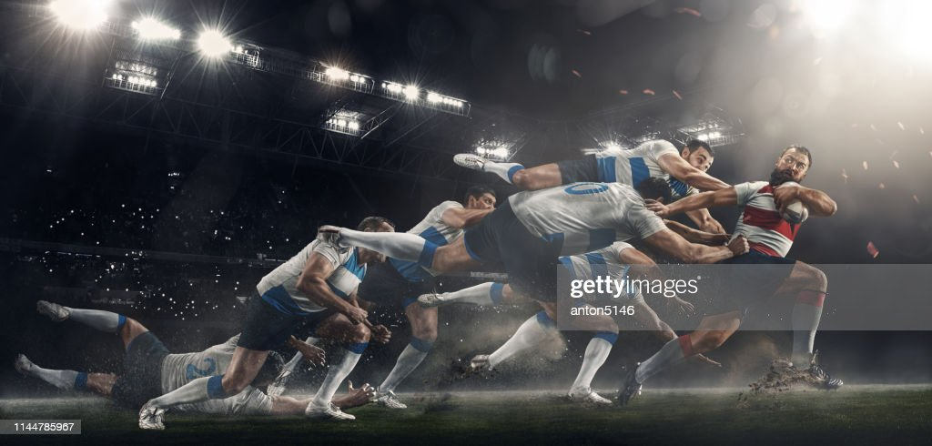Men are playing rugby at stadium : Stock Photo