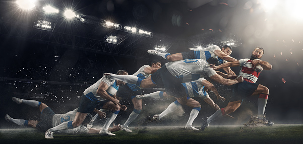 Men are playing rugby at stadium 1144785967